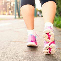 photo-of-woman-wearing-pink-sports-shoes-walking-1556710